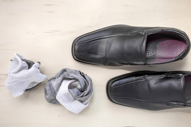 Men's leather shoes and socks Premium Photo