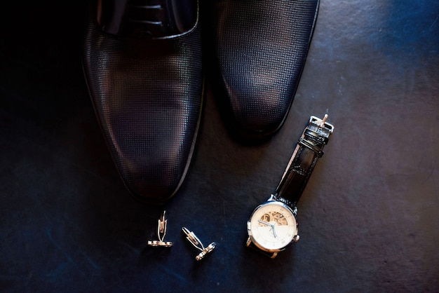 Men's leather shoes, watch and cufflinks Premium Photo