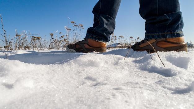 Men's winter boots on snow. brown men's warm winter boots closeup Premium Photo