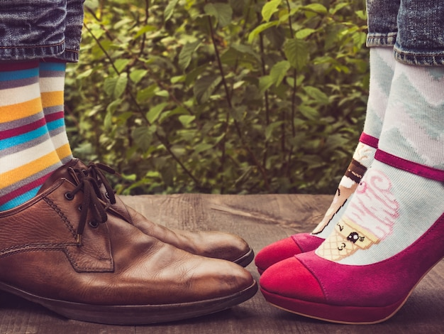 f967a2189 Men's and women's feet in stylish shoes, bright, colorful socks Premium  Photo