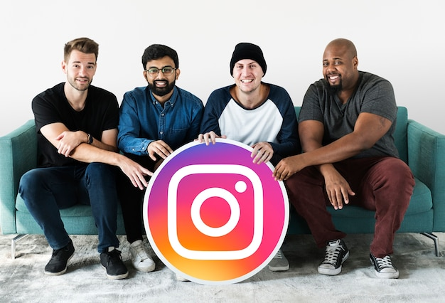 Men showing an instagram icon Free Photo