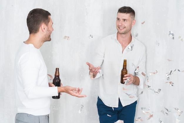 Men talking and drinking Free Photo