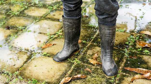 Men wear black boots for a flood. Premium Photo