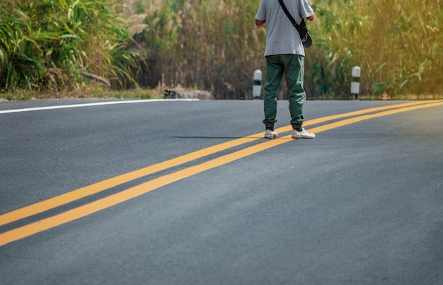Men wearing sneakers walking on the streets with yellow lines. Premium Photo