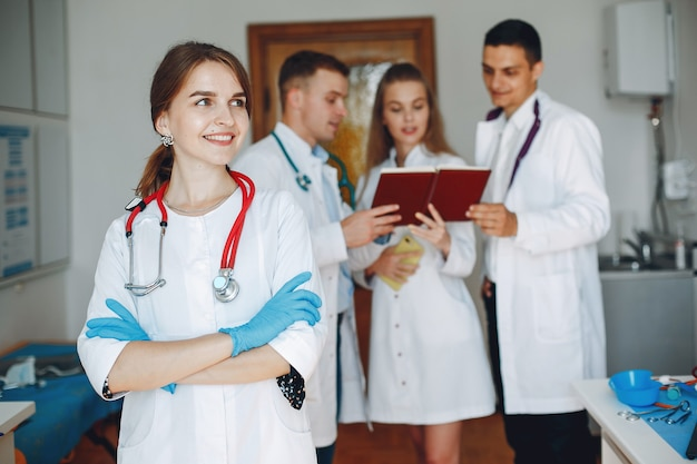 Men and women in hospital gowns study Free Photo