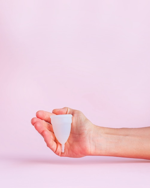 Menstrual cup on pink b Premium Photo