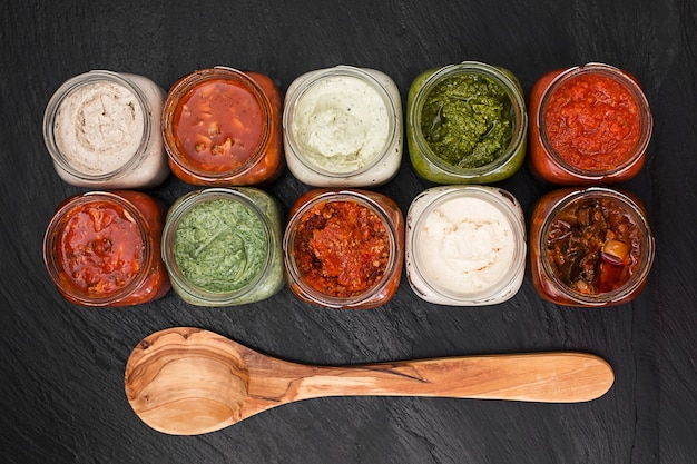 Menu concept with different sauces top view Premium Photo