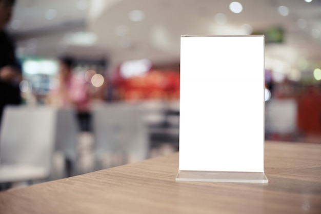 Menu Frame Standing On Wood Table In Bar Restaurant Cafe Photo - Standing cafe table
