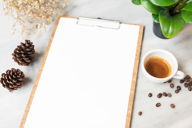Menu paper mockup with coffee cup in restaurant for input design list text. Premium Photo