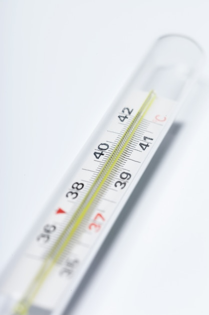 Mercury thermometer, isolated on white Premium Photo