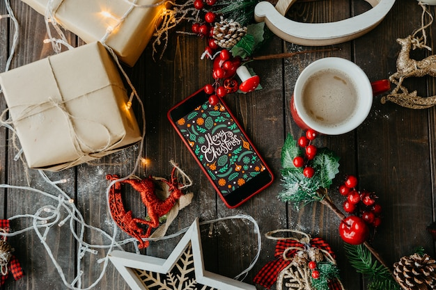 Merry christmas accessories with phone and coffee with milk Free Photo