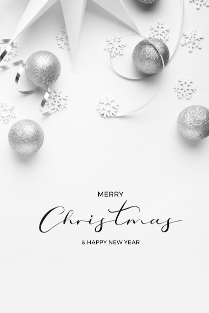 Merry christmas and happy new years greetins with silver tones on a white elegant background Free Photo