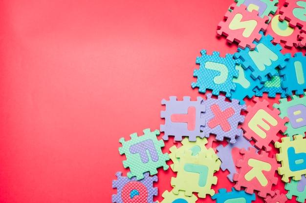 Messy arrangement of puzzles Free Photo