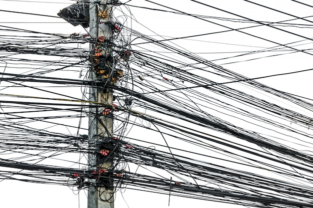 Premium Photo Messy Chaos Of Cables With Wires On Electric Pole On White Background The Many Electric Wire On The Power Poles
