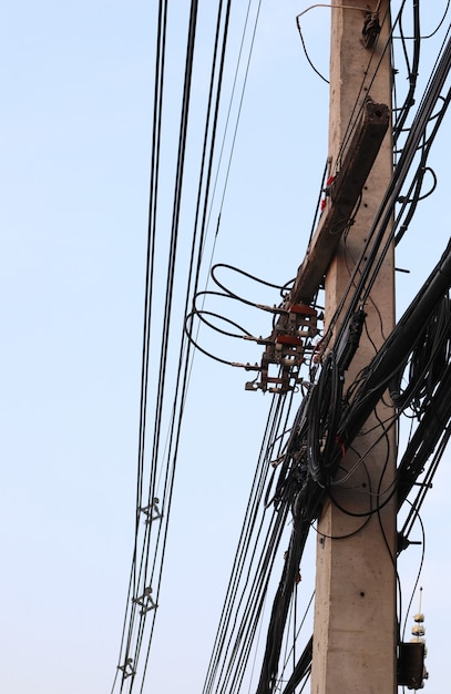 Messy Electrical Cables And Wires On Electric Pole Premium Photo