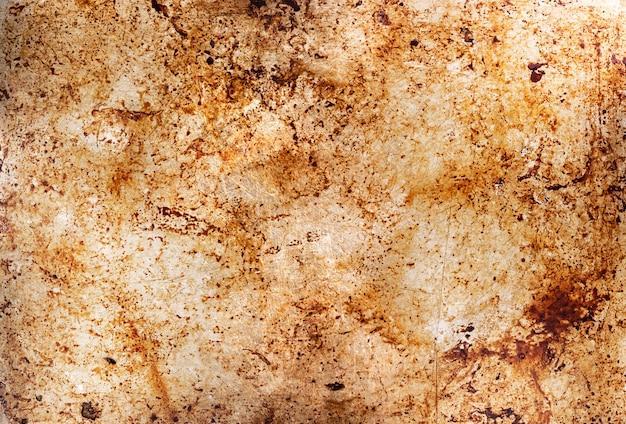 油汚れ、汚れたオーブンベーキングトレイ、油を塗った後の油で汚れたトレー表面の金属の背景 Premium写真