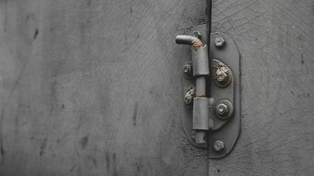 Metal door with bolt in grungy style with copy-space Premium Photo