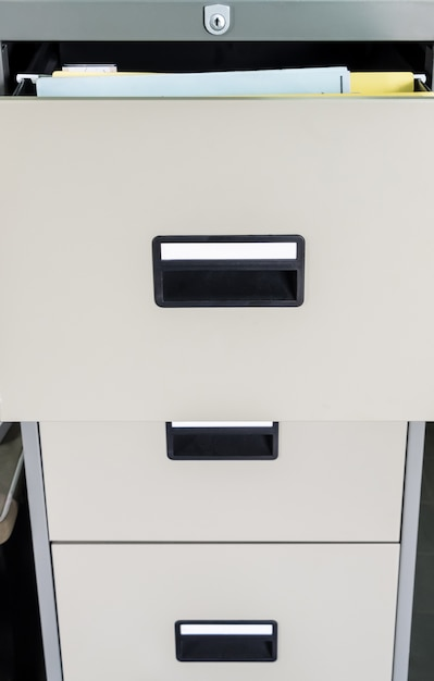 Metal file cabinet with open drawer. Premium Photo