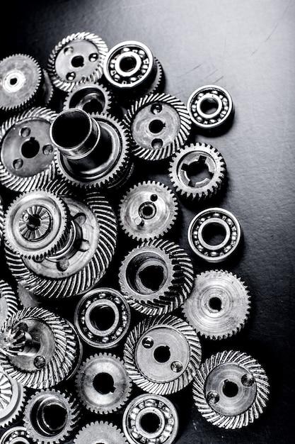 Metal gears on black surface Premium Photo