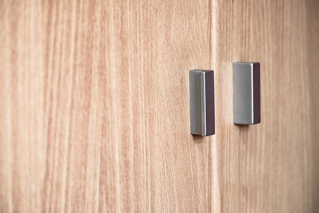 Metal handle on wooden wardrobe cabinet. Premium Photo