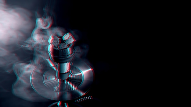 Metal hookah bowl with hot coals in the dark with smoke Premium Photo