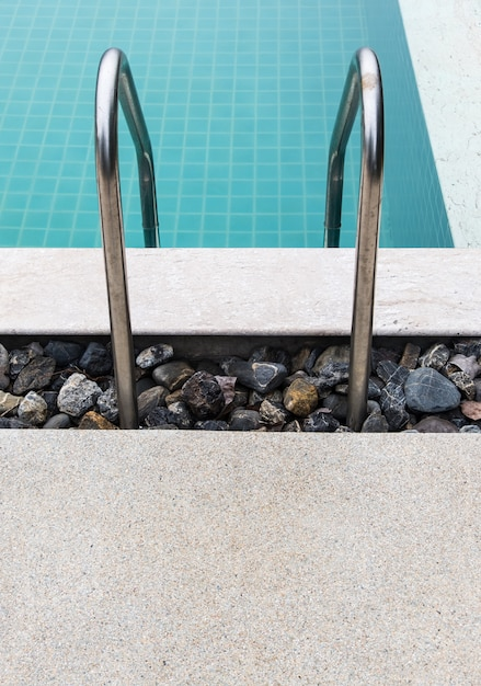 Metal rail of the ladder in a clear swimming pool Photo ...