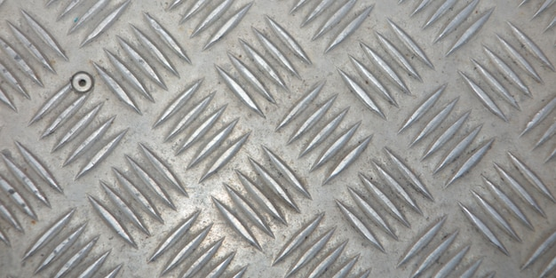 Metal silver industrial wall diamond steel pattern background texture for designer Premium Photo