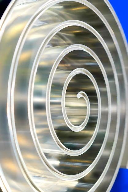 Metal spiral polished metal shallow depth of field. Premium Photo