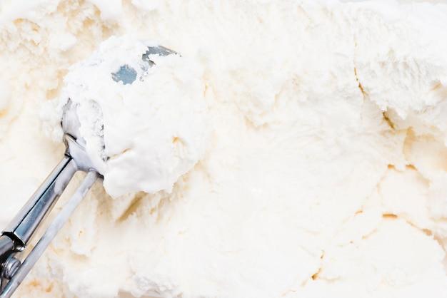Metal spoon in vanilla homemade ice cream Premium Photo