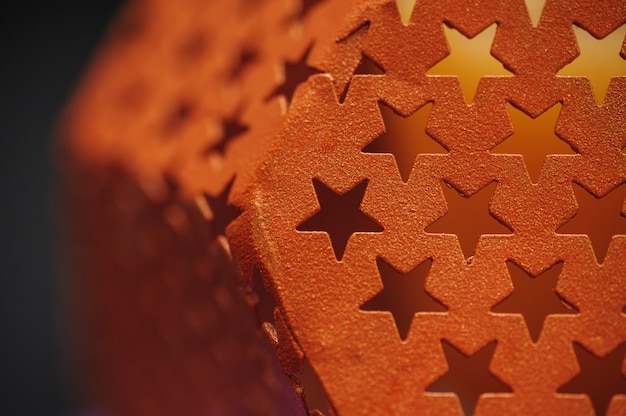 Metal texture with holes in the form of stars background Premium Photo