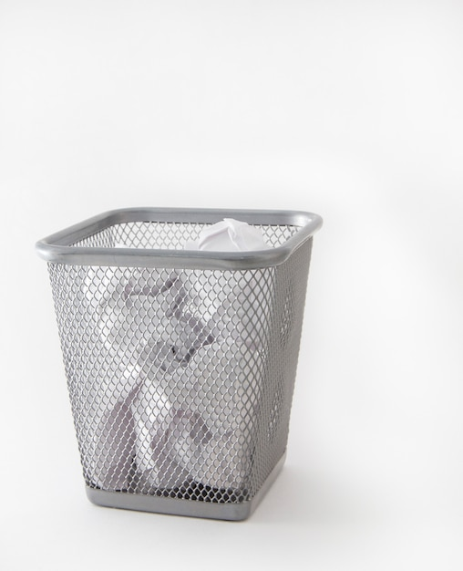 Metal trash can, bin with crumpled paper, isolated Premium Photo