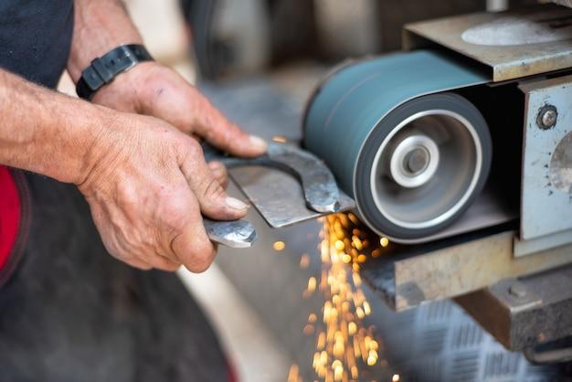 Metal working industry. finishing metal surface on grinding machine. Premium Photo
