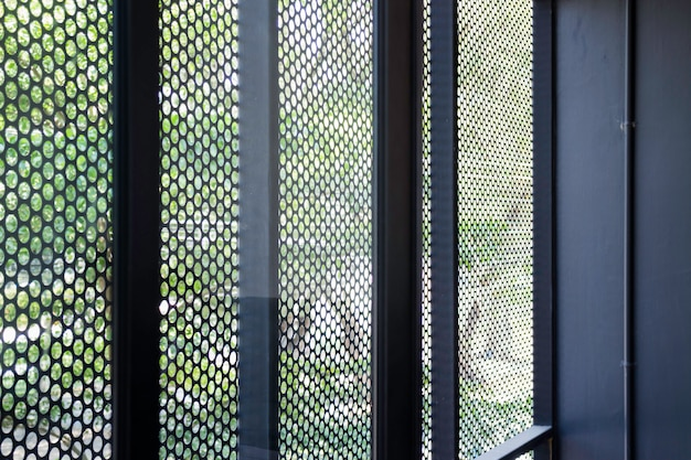 Metallic mesh grid net fence texture background Premium Photo