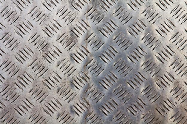 Metallic texture with geometric shapes Free Photo
