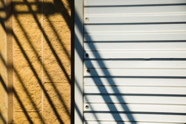 Metallic wall with shadow Free Photo
