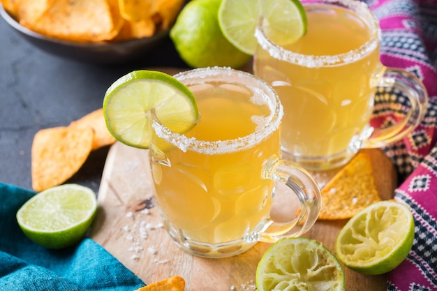 Mexican alcohol cocktail chelada with light beer and lime juice Premium Photo