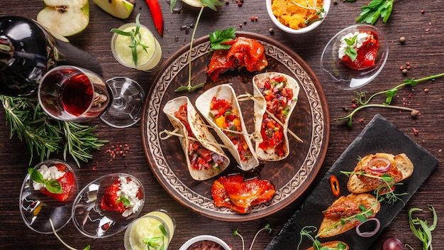 Mexican appetizer tacos with vegetables. Premium Photo