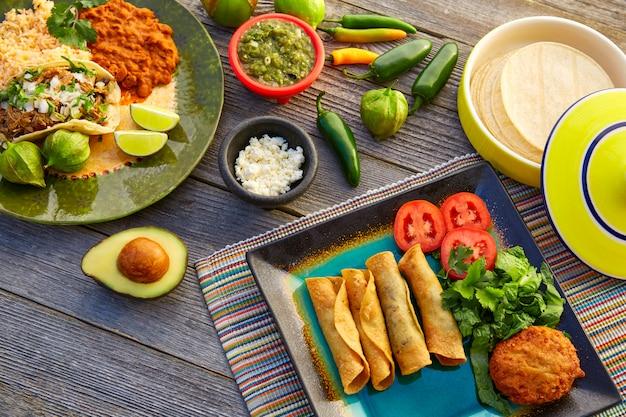 Mexican carnitas tacos with flautas from mexico Premium Photo