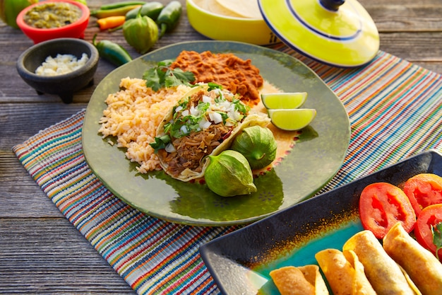 Mexican carnitas tacos with salsa and mexico food ingredients Premium Photo