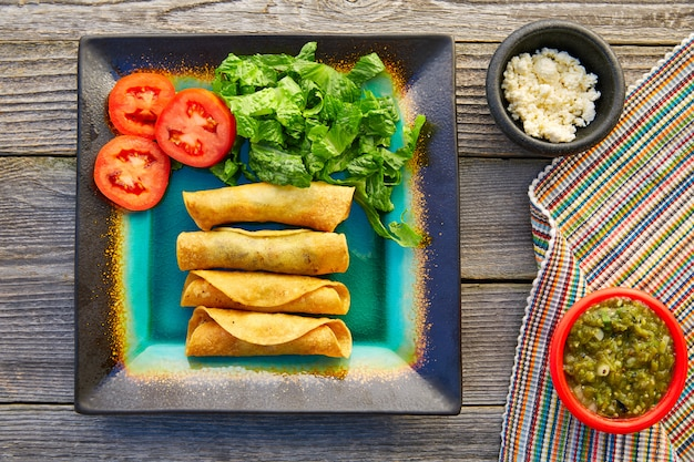 Mexican flautas rolled tacos with salsa Premium Photo