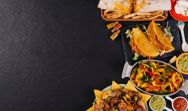 Mexican food on right side of tabletop Premium Photo