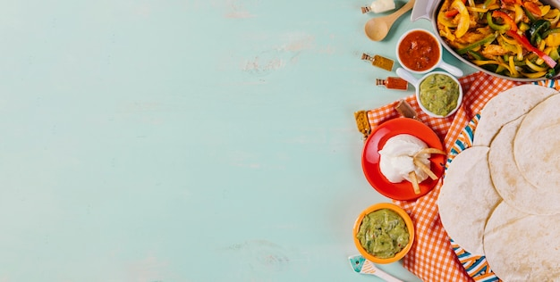Mexican food and tablecloth composition Free Photo