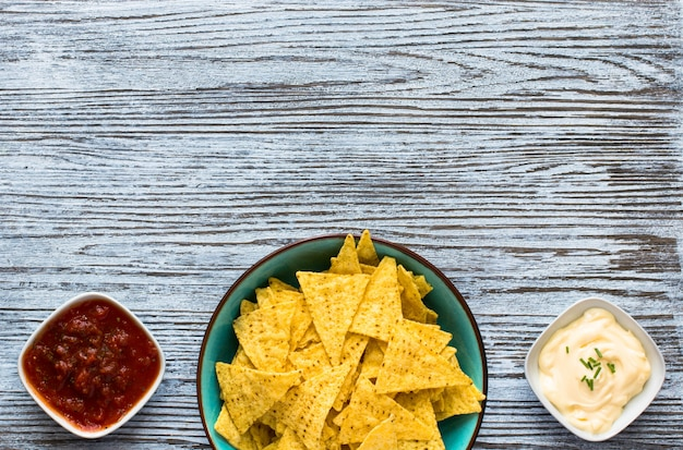 Mexican nachos chips  on wooden background Premium Photo