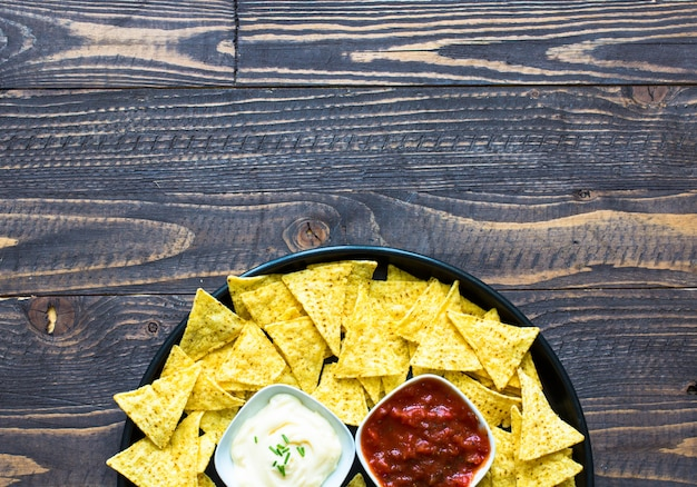 Mexican nachos chips  on wooden surface Premium Photo