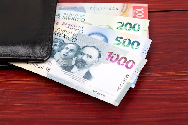Mexican peso in the black wallet Premium Photo