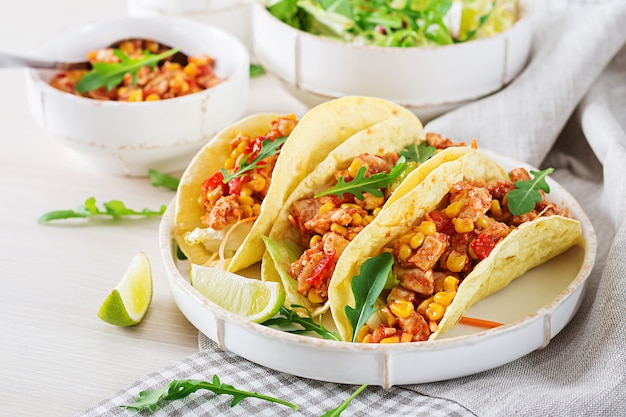 Mexican tacos with chicken meat, corn and tomato sauce. taco, tortilla, wrap. Premium Photo