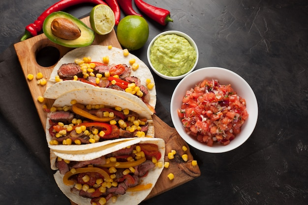 Mexican tacos with marbled beef and vegetables. Premium Photo