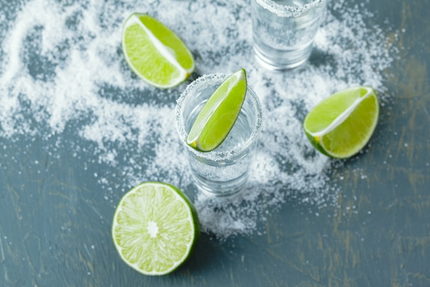 Mexican tequila in short glasses with lime and salt Premium Photo