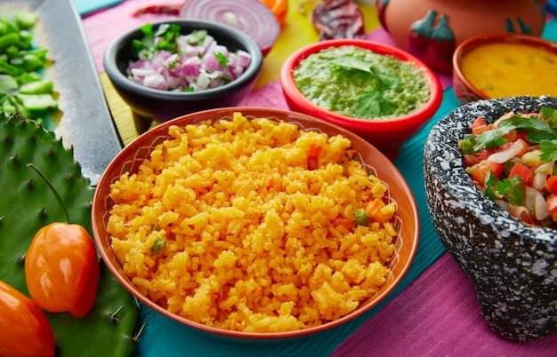 Mexican yellow rice with chilis and sauces Premium Photo