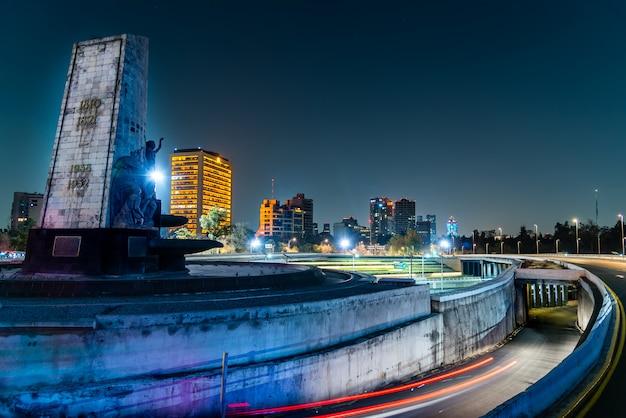 Mexico city night landscape, petroleum fountain and periferico highway Premium Photo